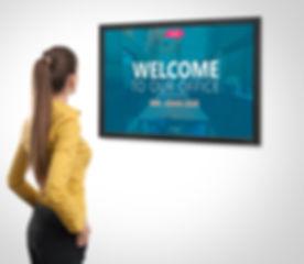 woman-looking-at-digital-signage-tv.jpg