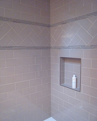Bathroom Subway Tile installed with herringbone accent and niche