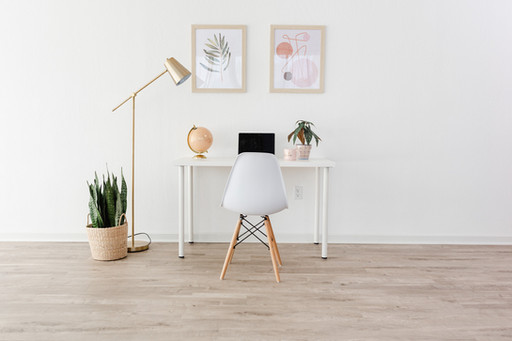 Office setup with a white table and white chair.