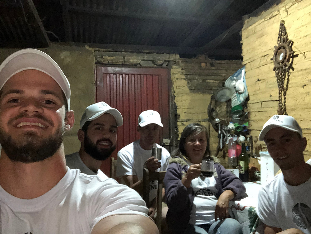 Kaffe Bueno founders and farmers cheering together in Colombia with organic coffee