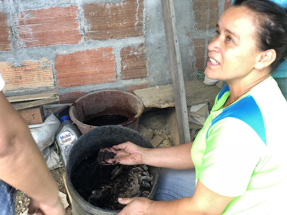 organic colombian coffee farmer showing kaffe bueno bio dynamic fertiliser