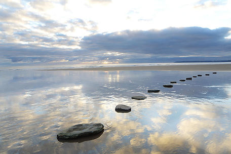 stepping-stones-over-water-with-sky-pete