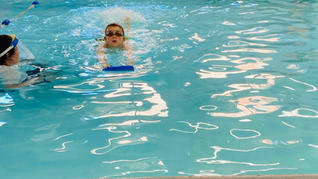 assistand and boy with float doing front