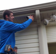 Electrician installing security camera