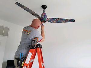 Brian installing Ceiling Fan.jpg