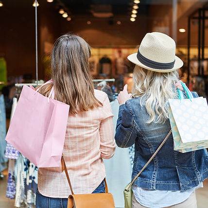 Two women shopping as customers in front