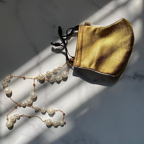 Gold face mask with pearl chain