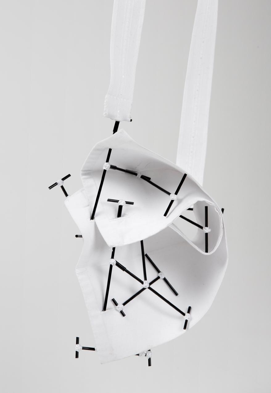 Caso 3 - Pendant, Shirt parts, brass, cotton thread, steel wire. 2015