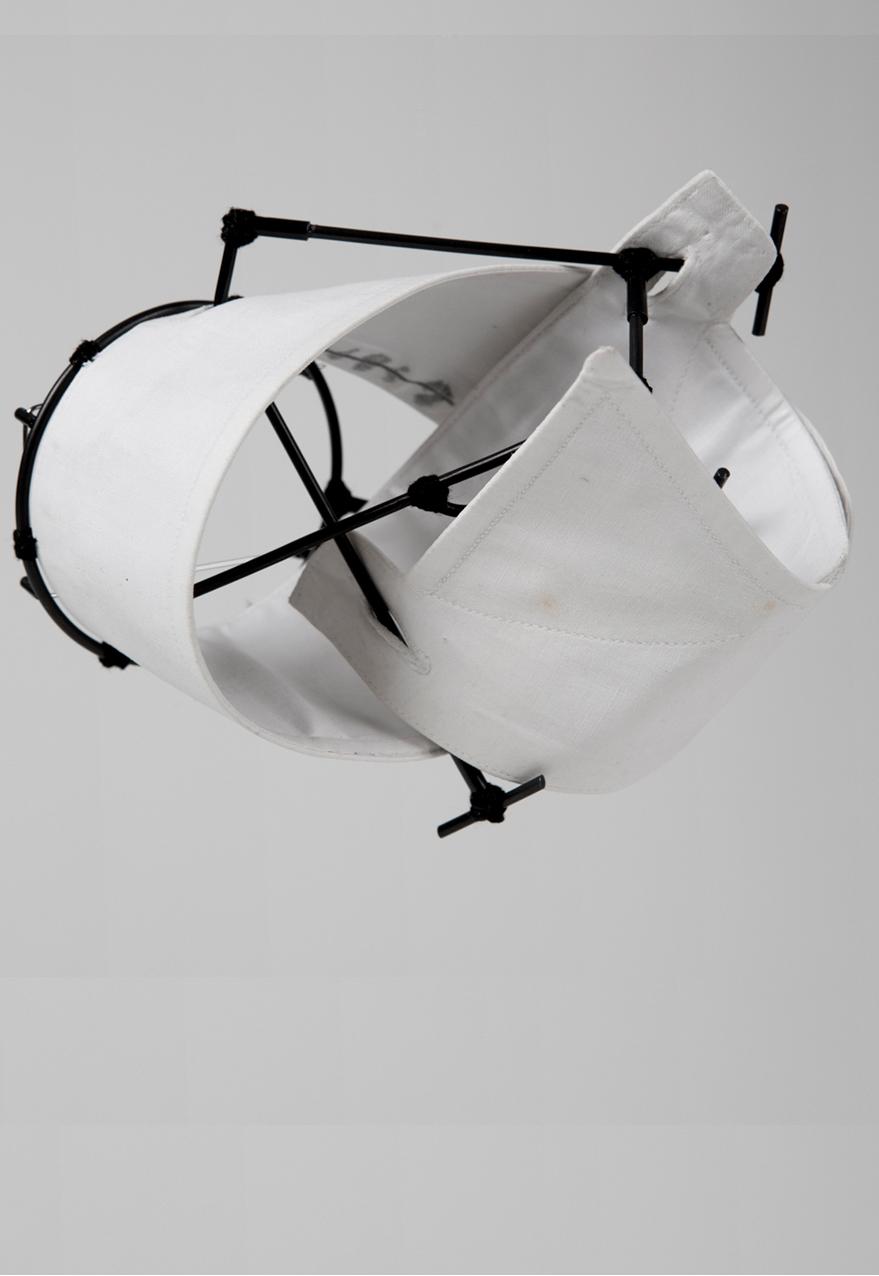 Caso 2 - Brooch  Shirt parts, brass, cotton thread, steel wire. 2015