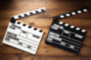 movie-clapper-board-at-wooden-background