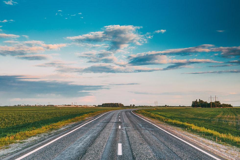 asphalt-open-road-through-spring-fields-