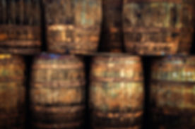 detail-of-stacked-old-wooden-whisky-barr