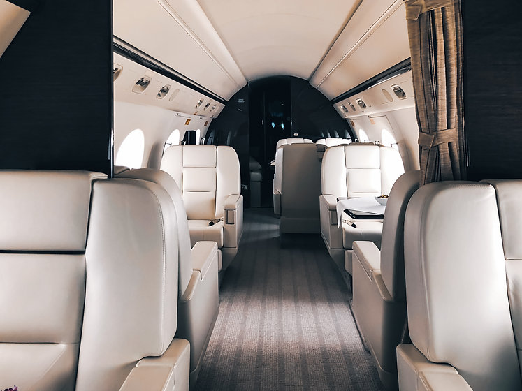 interior-of-a-private-luxury-jet-NWGHMJA