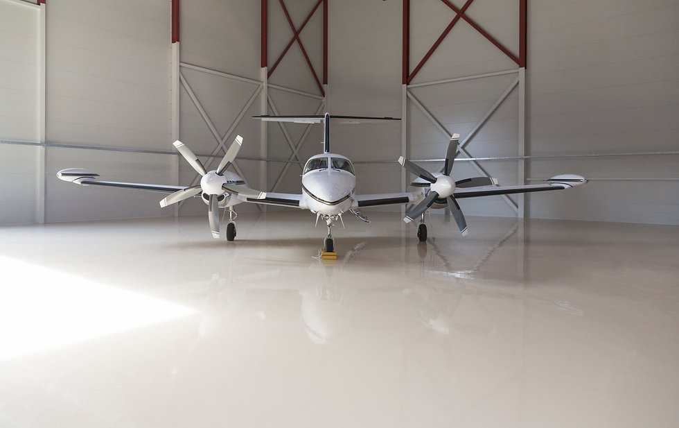 small-aircraft-parked-in-a-hangar-PV4BE7