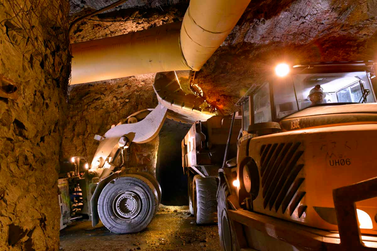 Mucker loading haul truck underground in