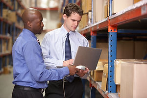 two-businessmen-with-laptop-in-warehouse