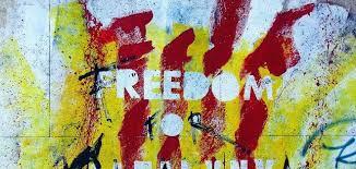 Grafiti con la palabra Freedom y la bandera de Cataluña