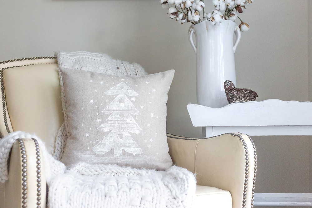 "Some people embellished the pillows. This pillow was embellished with embroidery using a french knot to make ""snow""."
