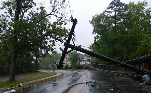 Image of fallen power pole and lines on roadway