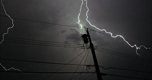 Image of lightning striking power pole