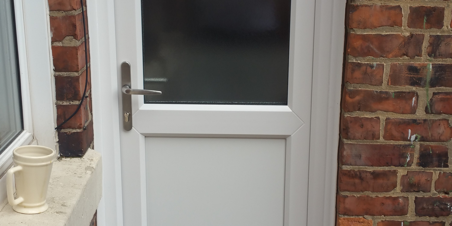 Simple uPVC Door. The best way to fit a secure door on a budget.