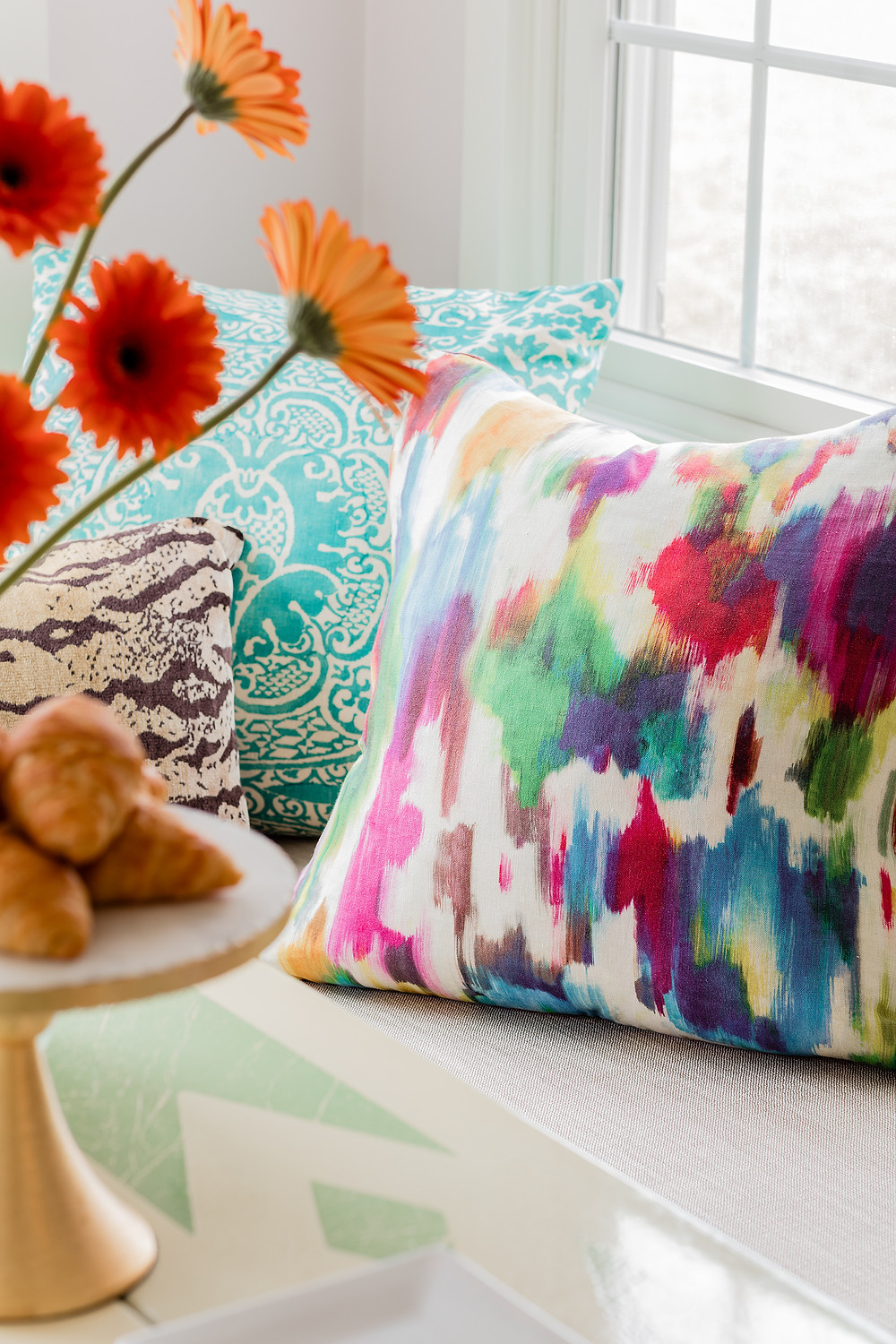 Robin Gannon Interiors colorful pillows and watercolor textiles