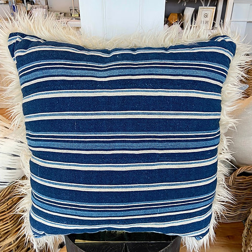 Cozy Nomad navy stripe pillow with faux fur