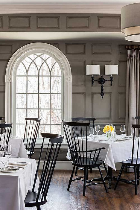 Dining room in restaurant at Inn at Hastings Park designed by Robin Gannon Interiors