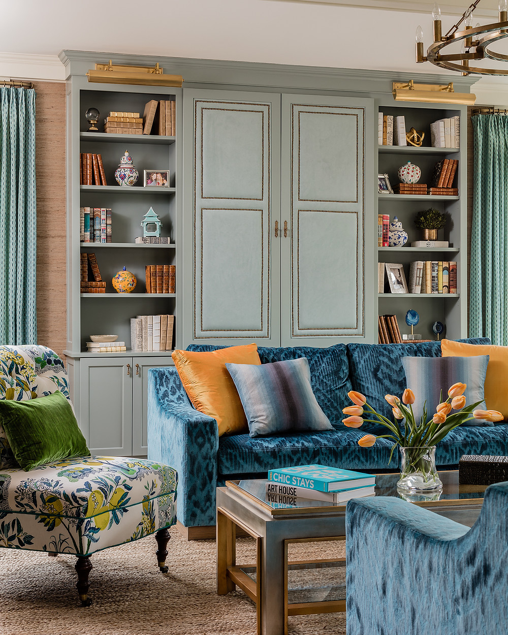 Robin Gannon Interiors, Brass Picture Lights, Blue Sofa, Green Pillow, Yellow Pillow, Blue Pillow, Styling, Tulips