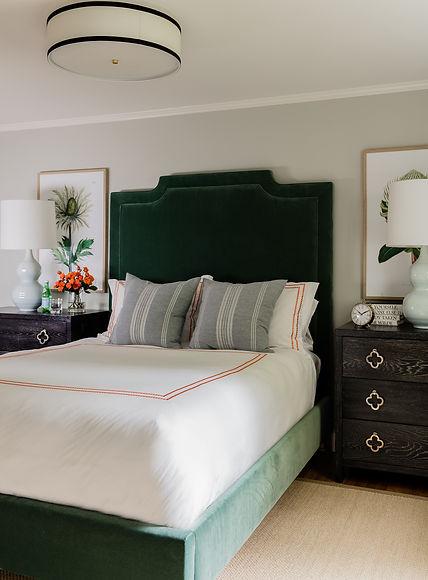 Bedroom with velvet headboard designed b