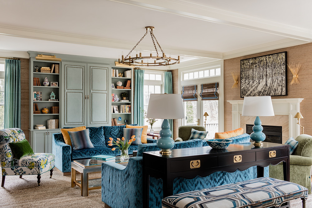 Robin Gannon Interiors, Custom Built Ins, Blue Sofa, Symmetrical Lamps, Colorful room, Brass Picture LIght