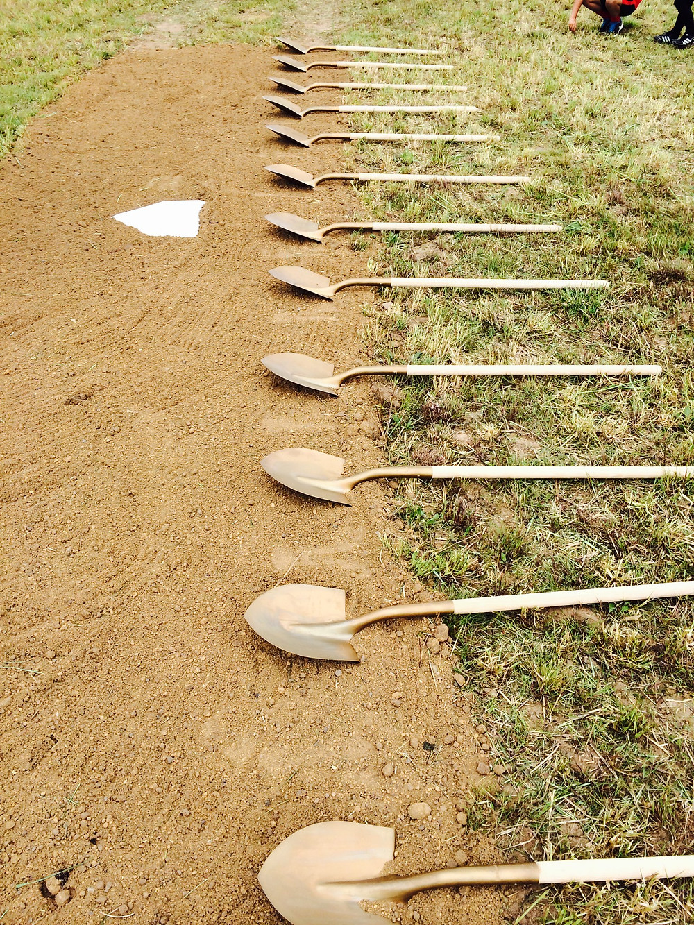 Shovels lined up w home plate.JPG