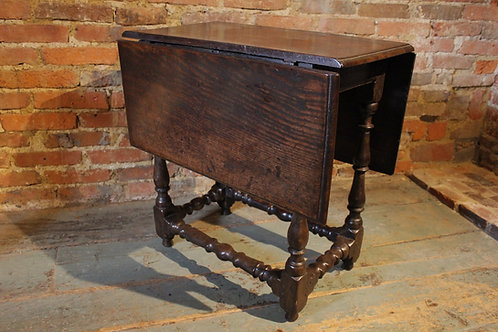 Very small 17th century oak drop flap table