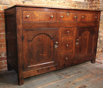 Small late 18th century oak dresser base.