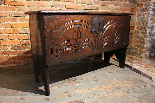 Lovely 17th century carved plank coffer