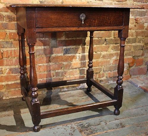 Early 18th century oak side table.