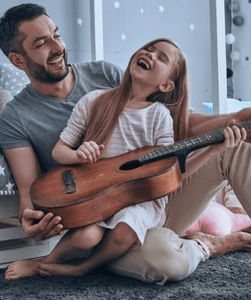 Father and Daughter happy guitar cropped