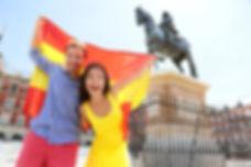 Madrid people showing Spain flag on Plaz