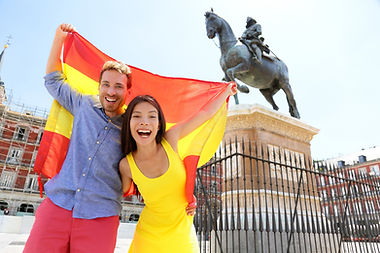 Madrid people showing Spain flag on Plaz