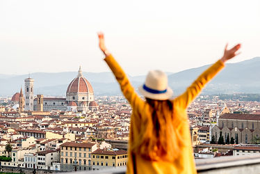 Young female tourist with raised hands l
