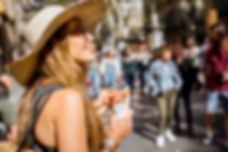 Young woman tourist holding jamon walkin