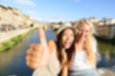 Happy women girl friends on travel in Fl