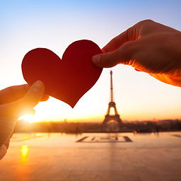 heart in hands, loving couple in Paris,