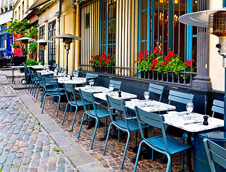 french restaurant - tables and chairs on