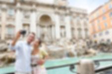 Tourist couple on travel taking selfie p