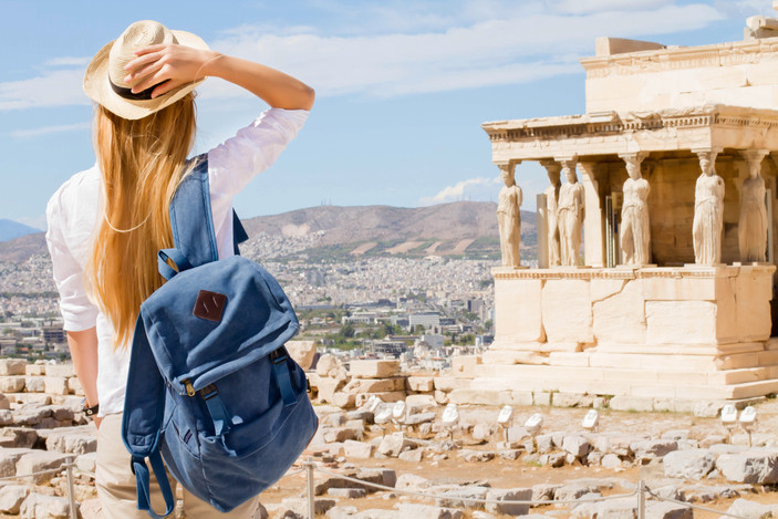 Hipster Traveler with backpack and outsp
