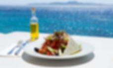Greek salad and olive oil on sunny sea s