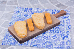 fish-nuggets-isolated-wooden-board