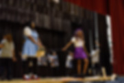 Students on stage performing The Wiz.jpg
