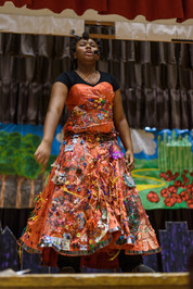 Female student performing during The Wiz